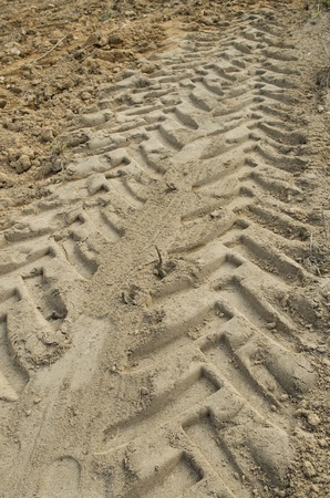 caused: Deep grooves caused by tractor wheels on the ground in the area of construction.(pattern  background)