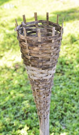 Korn: An Invention of woven bamboo for the flower or lantern put in install decoration in the garden for Mae Korn waterfall at ChingRai of Thailand  Stock Photo