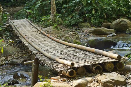 Korn: The Bamboo Bridge Over the Creek, Khun Korn Waterfall Forest Park, Chiang Rai Province, Thailand Stock Photo