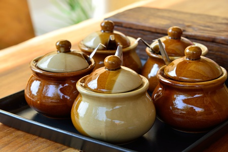 Condiment set made   of ceramic brown and spices inside  photo