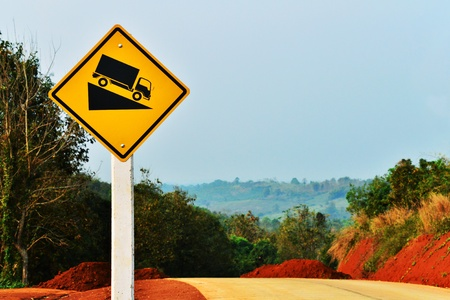 tractor warning sign: The warning bluff of road slope install at the road construction area  Stock Photo