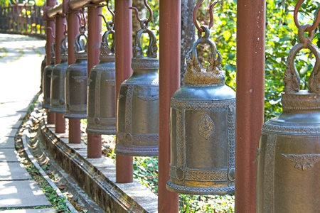 passages: Bronze bells hung on the line parallel passages up to the monastery  Stock Photo