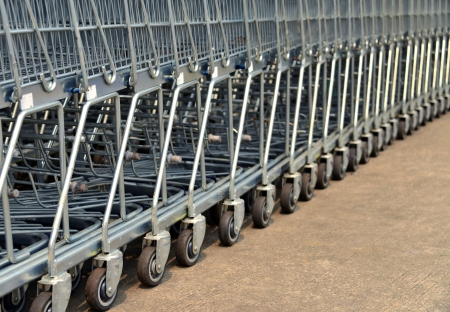stopped: Row of shopping trolleys stopped lined at parking area