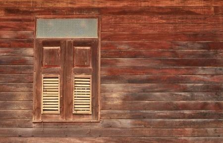 holdfast: Wooden wall of ancient house with window closed