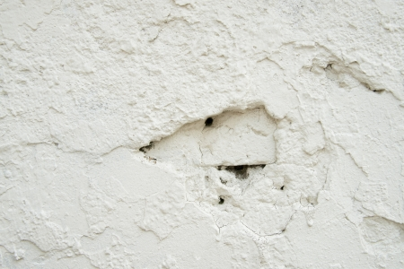 pernicious: Texture background of cracking traces on a white concrete wall