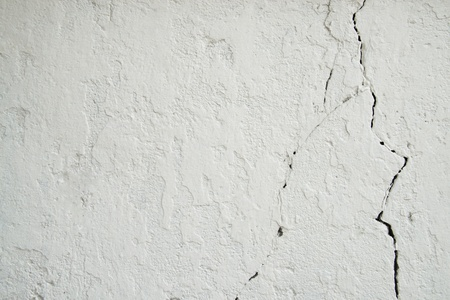 cracking: Texture background of cracking traces on a white concrete wall