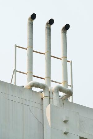 evaporate: White industrial metal chimney