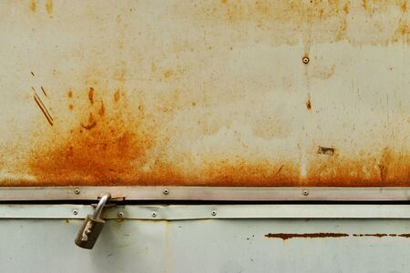 Background of rusty grunge metal trunk with master key photo
