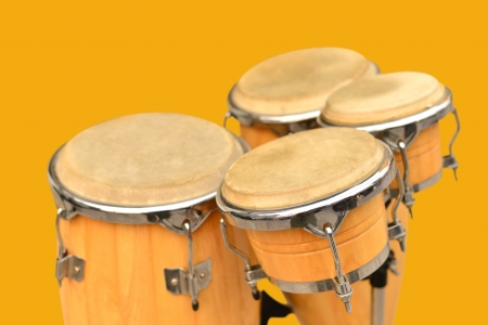 toca: Conga drum set on yellow background  Stock Photo