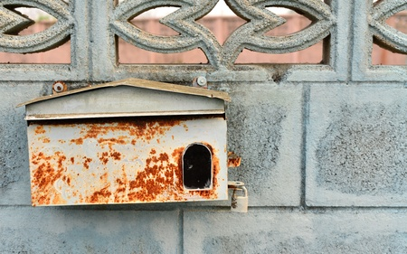 get out: The old post office box are rust install on waste factory wall