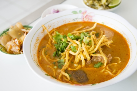 thai noodle soup: Thai rice noodles with chicken curry soup  Khao Soi Gai  - The original recipes   favorite traditional food of Northern in Thailand  Stock Photo