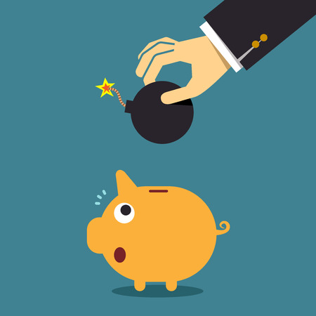 financial emergency: Businessman hand put a bomb to explode the piggy bank, Business concept