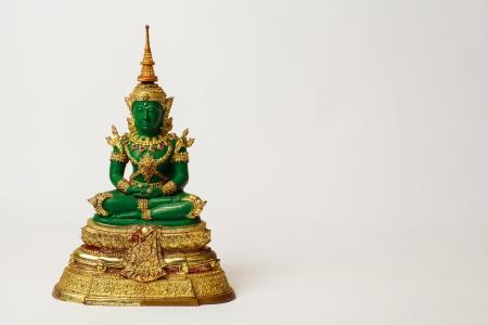 Emerald buddha ,shadow on right hand side  photo