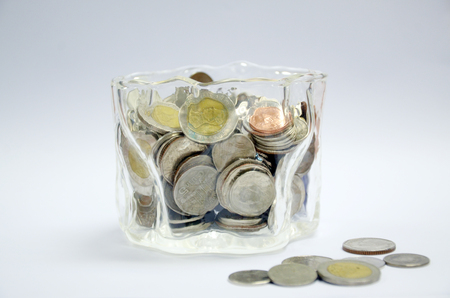 Coins in Glass on white background 版權商用圖片