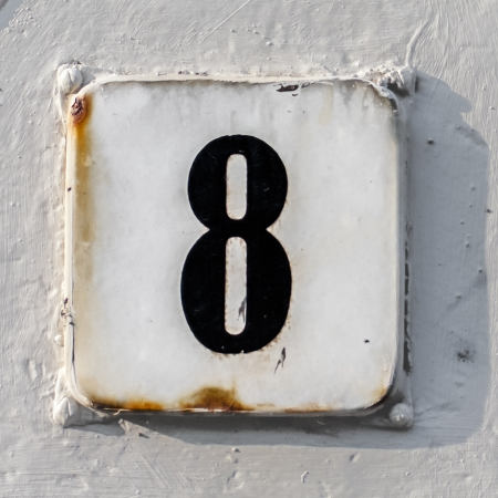 clumsy: house number 8, clumsy painted around. Stock Photo