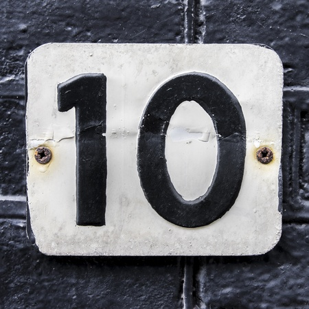 embossed: house number 10 embossed in a metal plate