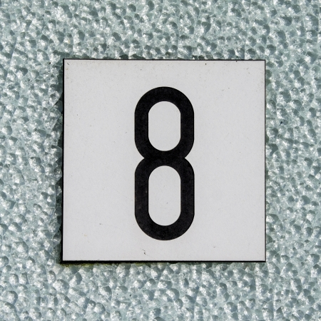 house number eight on a glass relief window Stock Photo - 13608079