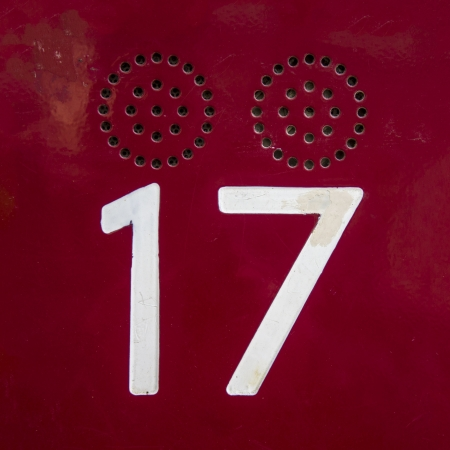 seventeen: white engraved house number seventeen , next to an intercom grid Stock Photo