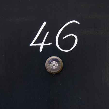 peephole: house number forty six above a small peephole