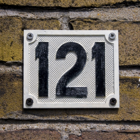 cast metal type: cast metal house number hundred and twenty one Stock Photo