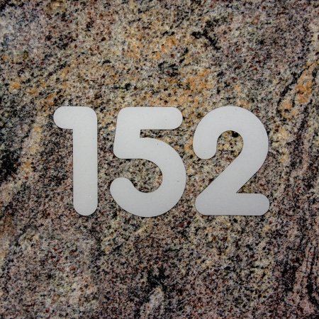 house number one hundred and fifty-two on a marble wall photo