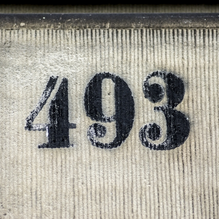 house number four hundred and ninety three painted on a wall photo