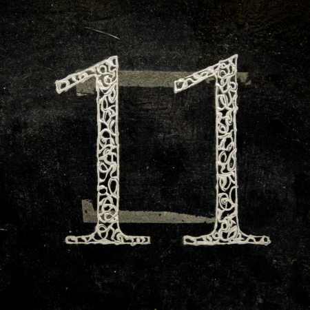 eleven: fancy house number eleven on a lacquered black background Stock Photo