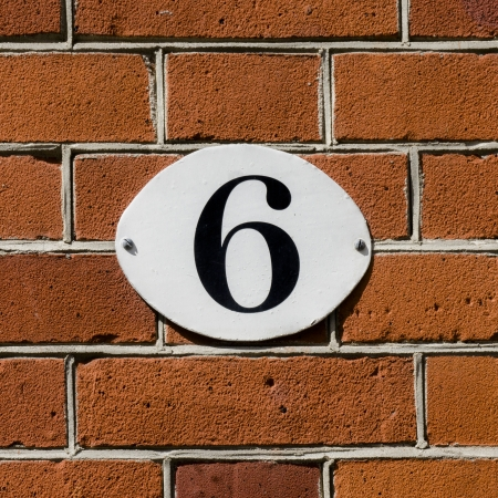 new house number six on an oval plate Stock Photo - 13767116
