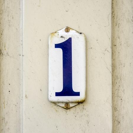 number one: enameled house number one  Blue lettering on a white background