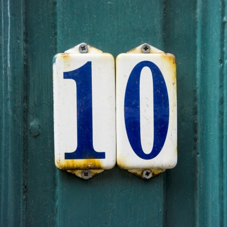 enameled: House number ten on two separate enameled plates  Stock Photo