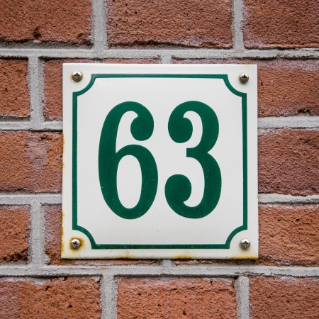 enameled: green house number sixty-three on an enameled plate Stock Photo