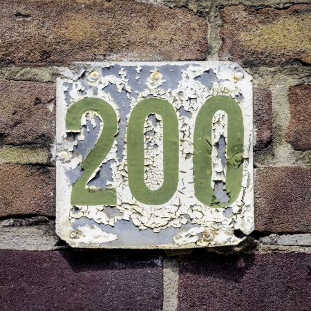 flaking: heavily weathered and flaking house number two hundred
