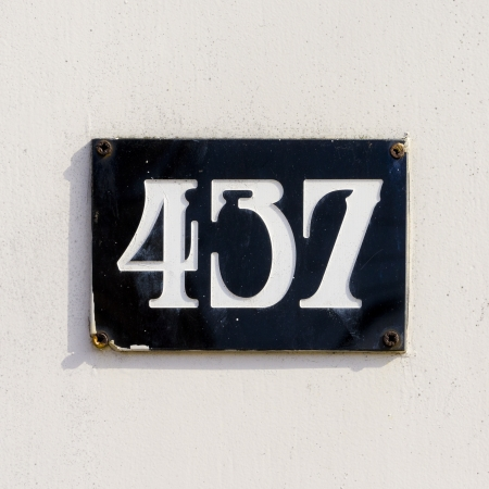 house number four hundred and thirty-seven. White lettering engraved in a black plate. photo