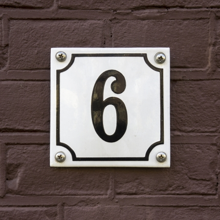 new house number six on an enameled plate photo