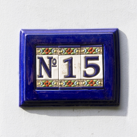 ultramarine blue: Ceramic house number fifteen, surrounded by an ultramarine blue frame