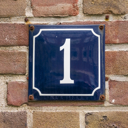 number one: enameled house number one. White lettering on a blue background