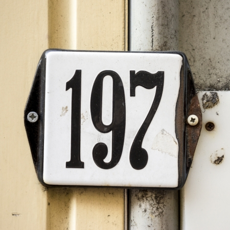 enameled: enameled house number one hundred and ninety-seven on a messy background Stock Photo