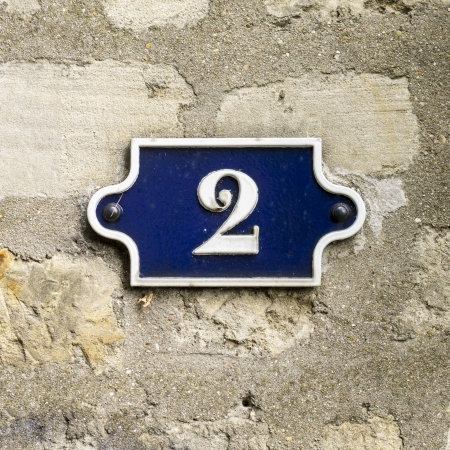 cast metal type: cast metal house number two  White lettering on a blue background Stock Photo