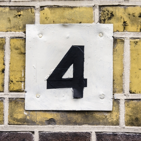 House number four, black lettering on a white plate photo