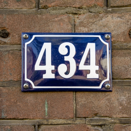 house number four hundred and thirty four  White lettering on a blue enameled plate  photo
