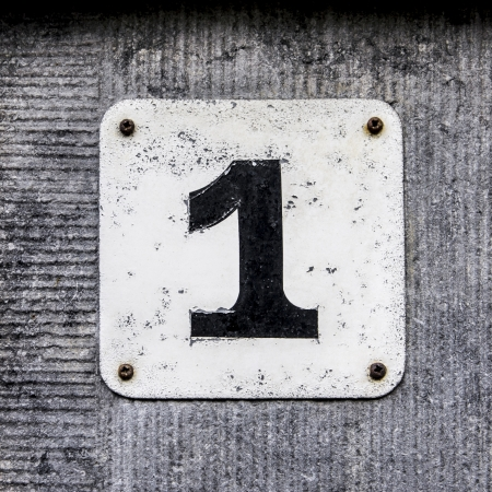 House number one   Black lettering on a white plate photo