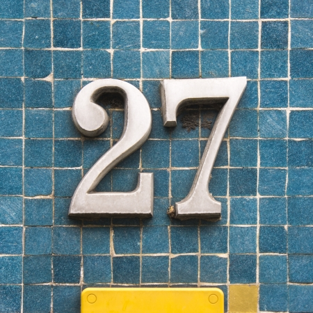 cast metal type: House number twenty seven made out of cast iron Stock Photo
