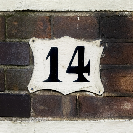 number 14: house number fourteen on a brick wall.