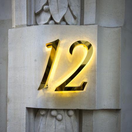 Golden house number twelve with backlight
