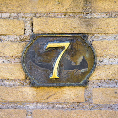 cast metal type: house number seven made of cast metal. Stock Photo
