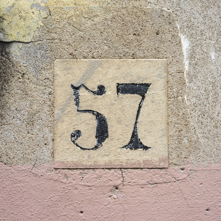 house number fifty seven, engraved in a stone tile photo
