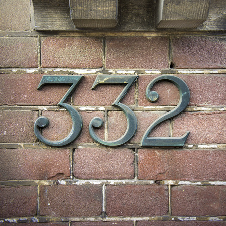 cast metal type: bronze house number three hundred and thirty two