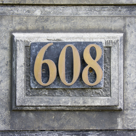 cast metal type: Bronze house number six hundred and eight.