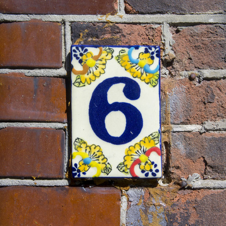 hand crafted: hand crafted ceramic house number six Stock Photo