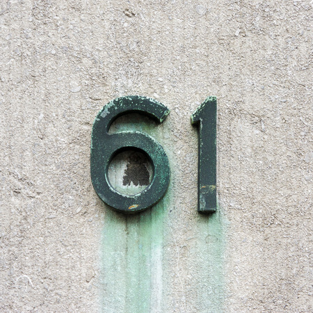 cast metal type: bronze house number sixty one Stock Photo